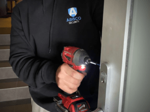 locksmith working on door